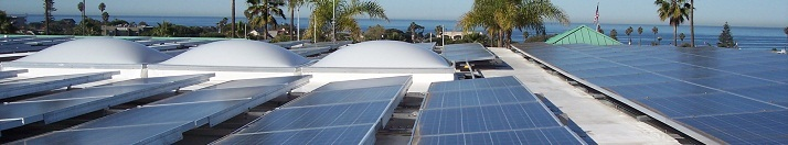 An array of solar panels on top of the City of Encinitas City Hall Building