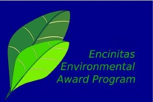 "City of Encinitas Environmental Commission's Environmental Award Program Logo: Royal Blue Background with 2 Green Leaves and the words ""Encinitas Environmental Award Program"""