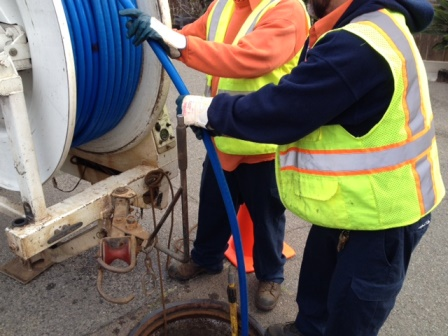 crew cleaning sewer pipes